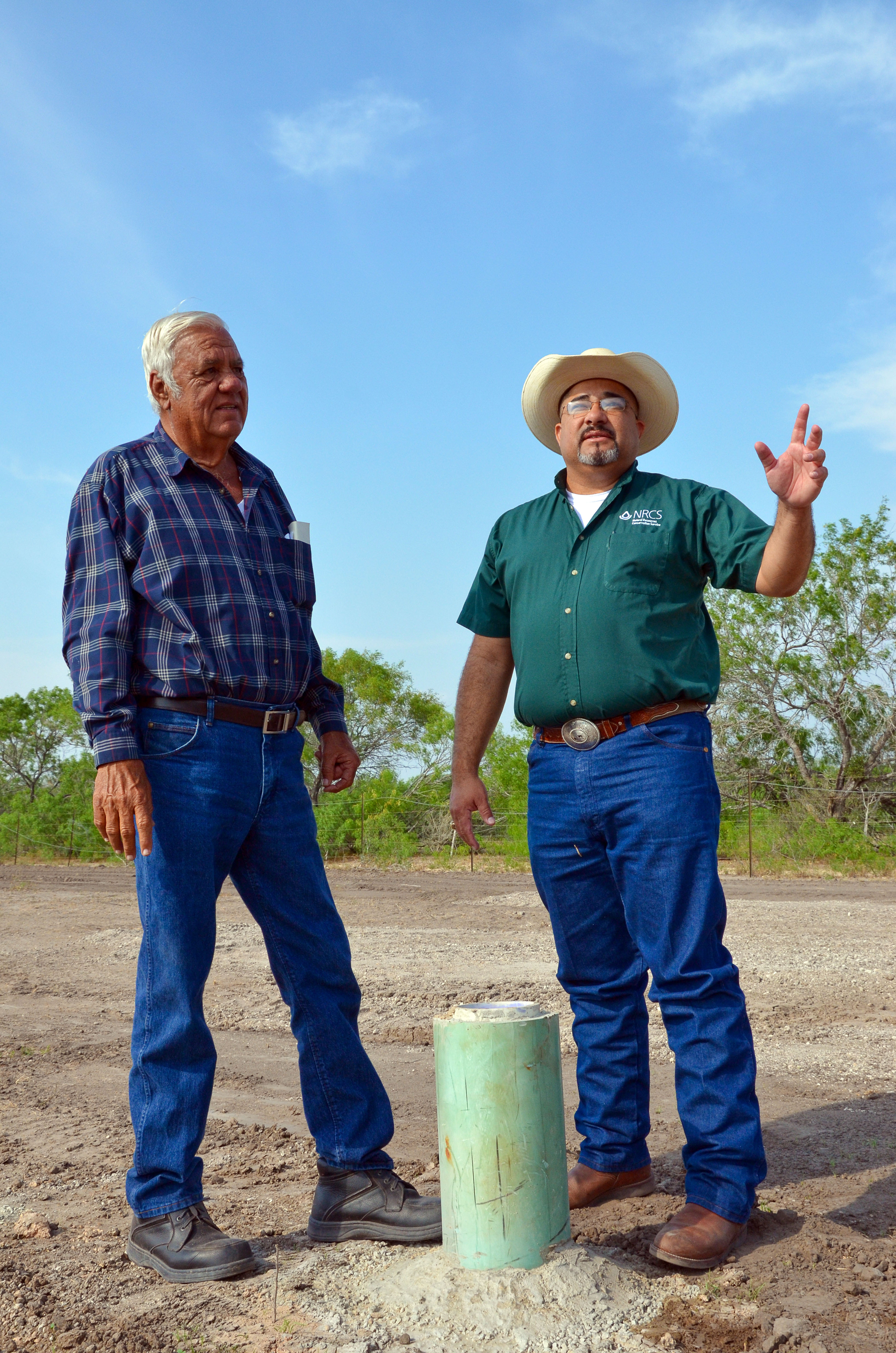 Rancher Willie Utley of Benavides, Texas (left), and Sammy Guerra, NRCS district conservationist, st