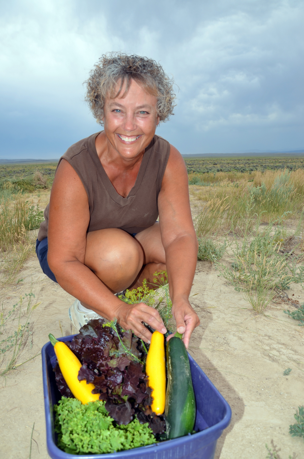 Carol Huether, of Spring Creek, Nev., displays some of the herbs and vegetables she grows on her far
