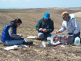 Soil scientists working in the field.