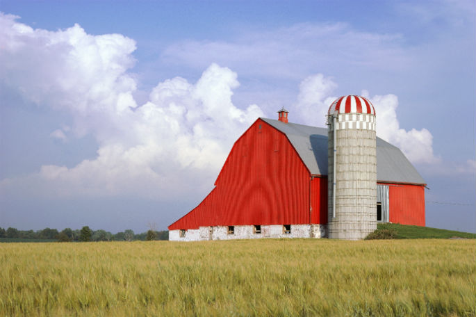 Classic red American barn and grain silo.