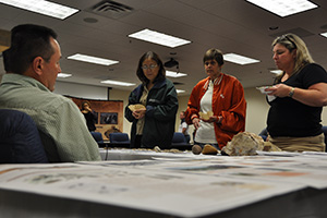 NRCS employees learn about cultural resources and artifacts during American Indian Heritage month.