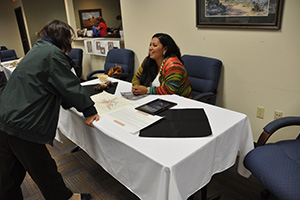 NRCS employees share stories and artifacts during an American Indian Heritage month event.