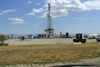 A 3.8 acre gas exploration well pad near Pindale, Wyoming. The un-vegetated area around the drill rig will be reclaimed after exploration is completed.