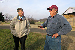State Conservationist Jack Bricker confers with Gerry Silver prior to the release announcement for the new CEAP report at Silver Ridge Farm.