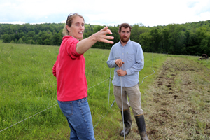 Kate Parsons and Sean Stanton check out the improvement of his pasture.
