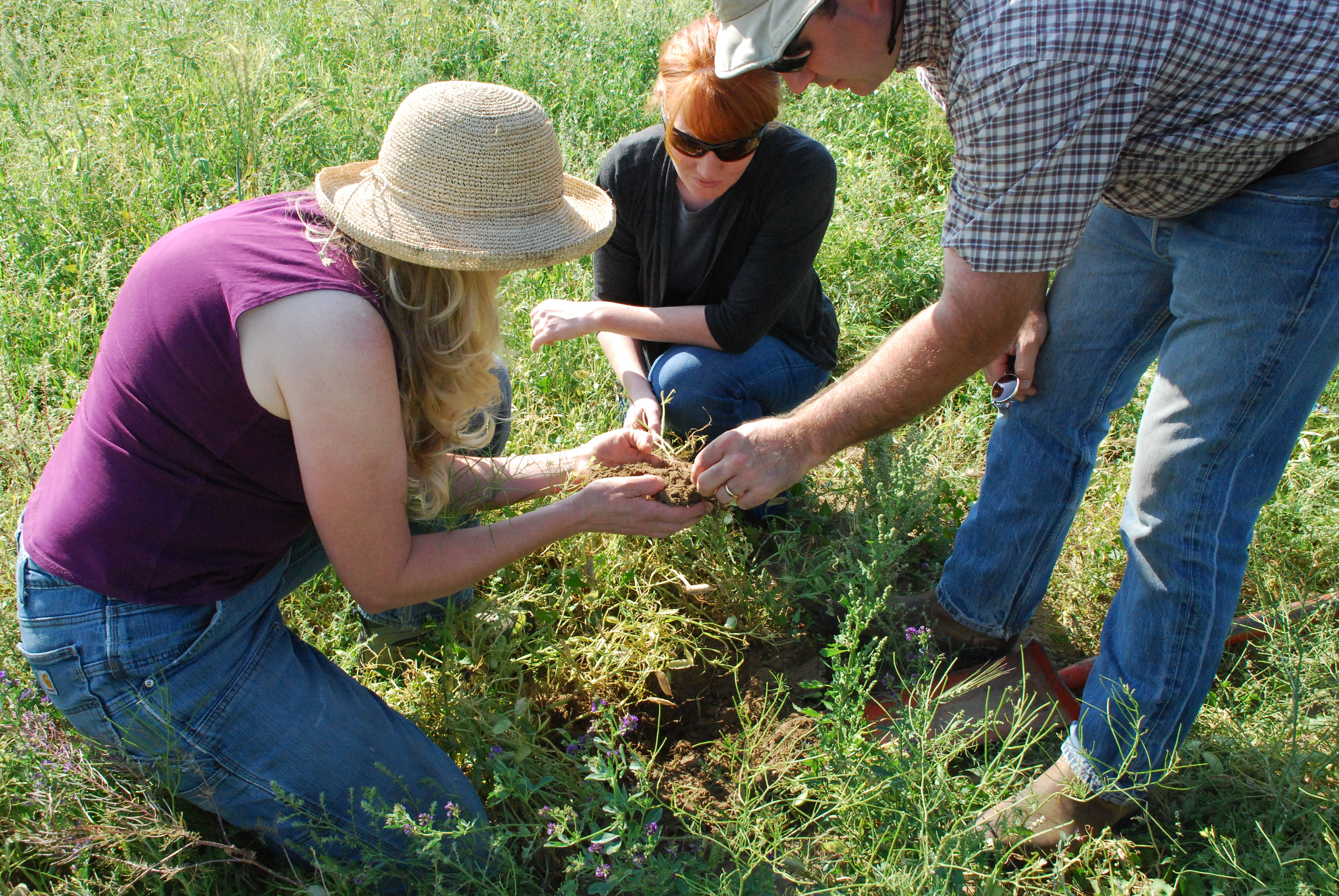 Anna Jones-Crabtree and Doug Crabtree discuss soil health with NRCS Soil Conservationist Amy Kaiser.