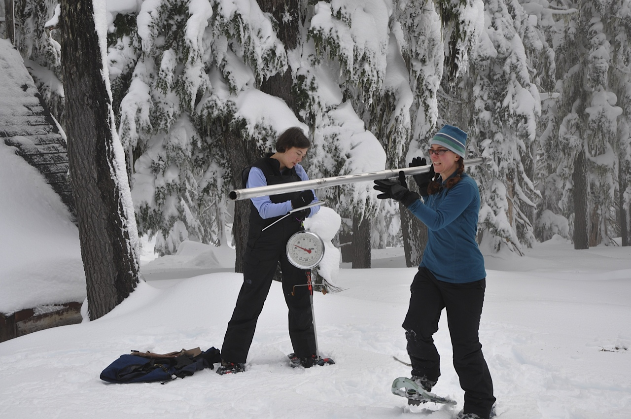 NRCS Oregon hydrologists Melissa Webb and Julie Koeberle measure snow on Mount Hood, Ore.