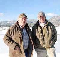 Joe Boyer, left, rancher near Frenchtown, Montana, shows USDA Under Secretary Robert Bonnie land he has placed in a Farm and Ranch Lands Protection Program easement.