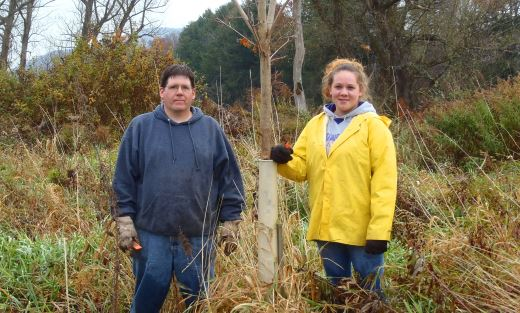 Matt Houck and Shelby Jennings volunteered to remove tree tubes on new trees in the NYC watershed