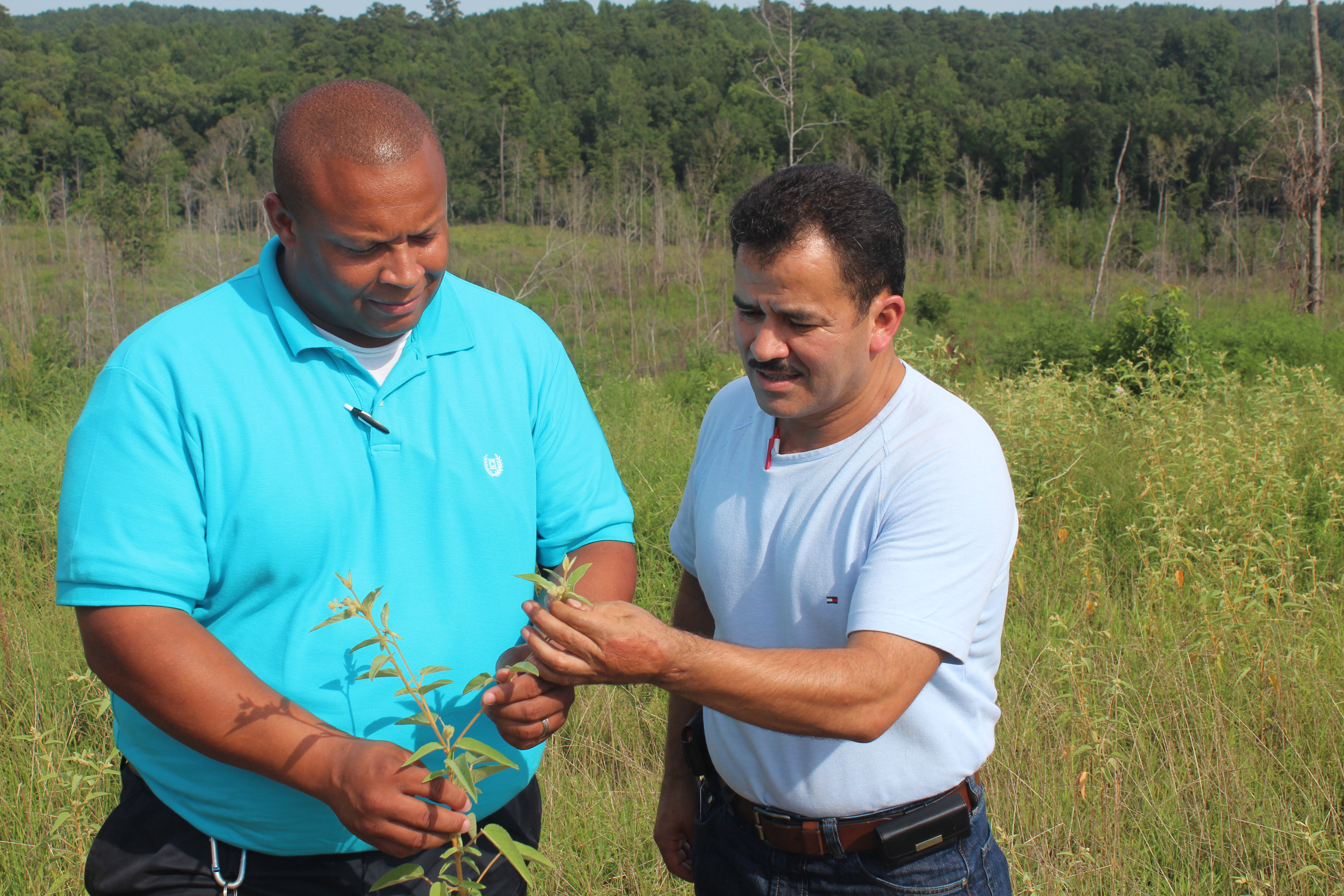 "NRCS Supervisory District Conservationist Kelvin Jackson worked with Variano ""Chino"" Suarez on improving forested lands with conservation programs"