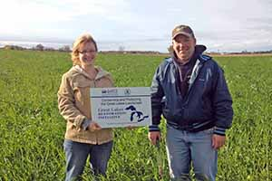 farmer receives recognition sign from NRCS