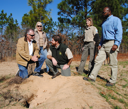 NRCS and State partners visit with landowners to inspect gopher tortoise burrows.