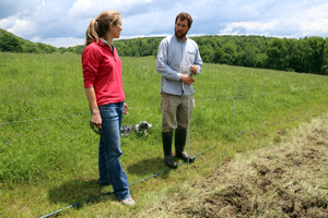 An NRCS planner and a farmer discuss conservation options in a field.