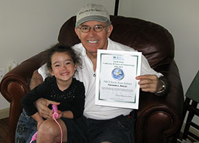 Earth Team volunteer holding certificate of appreciation