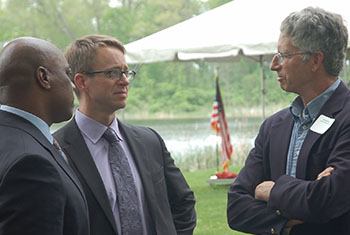 NRCS Chief Jason Weller (center) speaks with State Conservationist Garry Lee (left) and Brian Price, executive director of the Leelanau Conservancy at an event to announce funding for the new Regional Conservation Partnership Program.