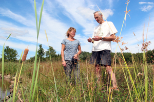 An NRCS employee and landowner working in partnership to restore wetlands.