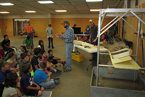 NRCS and Pheasants Forever team up to educate students on the kind of crops grown in the local area