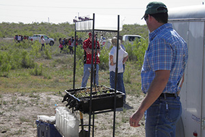 Cliff Kiinibrugh explains erosion and water contamination using a rainfall simulator.