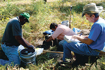 Soil scientists in the field.