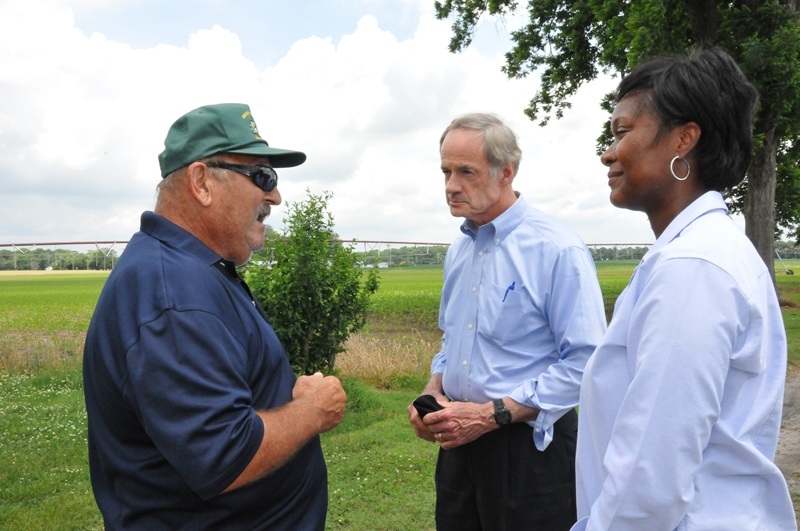 Farmer Richard Miller of Seaford (L) talks with Senator Carper and NRCS STC Kasey Taylor about NWQI.