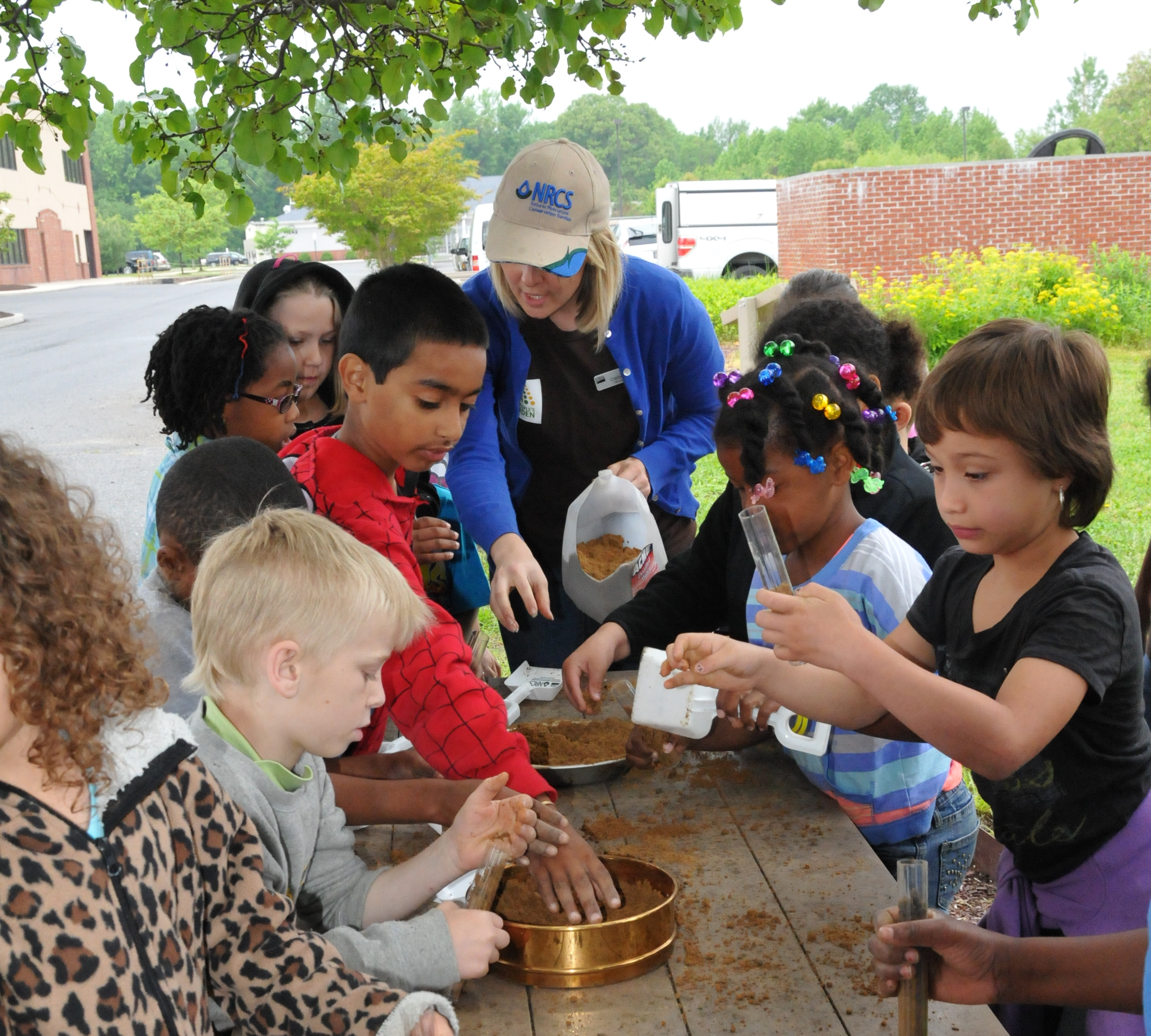 NRCS employees teach North Dover Elementary students how to make their own soil tube.