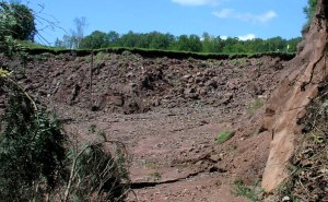 Erosion on an auxiliary spillway that occurred after an 500 year event (14 inches in 24 hours during Hurricane Irene). Auxiliary spillways should not breach during a Probable Maximum Precipitation (30 inches in 24 hours) event according to NRCS criteria for high hazard dams in TR-60. Click image for full screen view