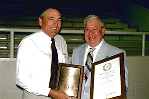 (L) Former TX NRCS State Conservationist Wes Oneth presents award to producer Jack Schuster in 1995.