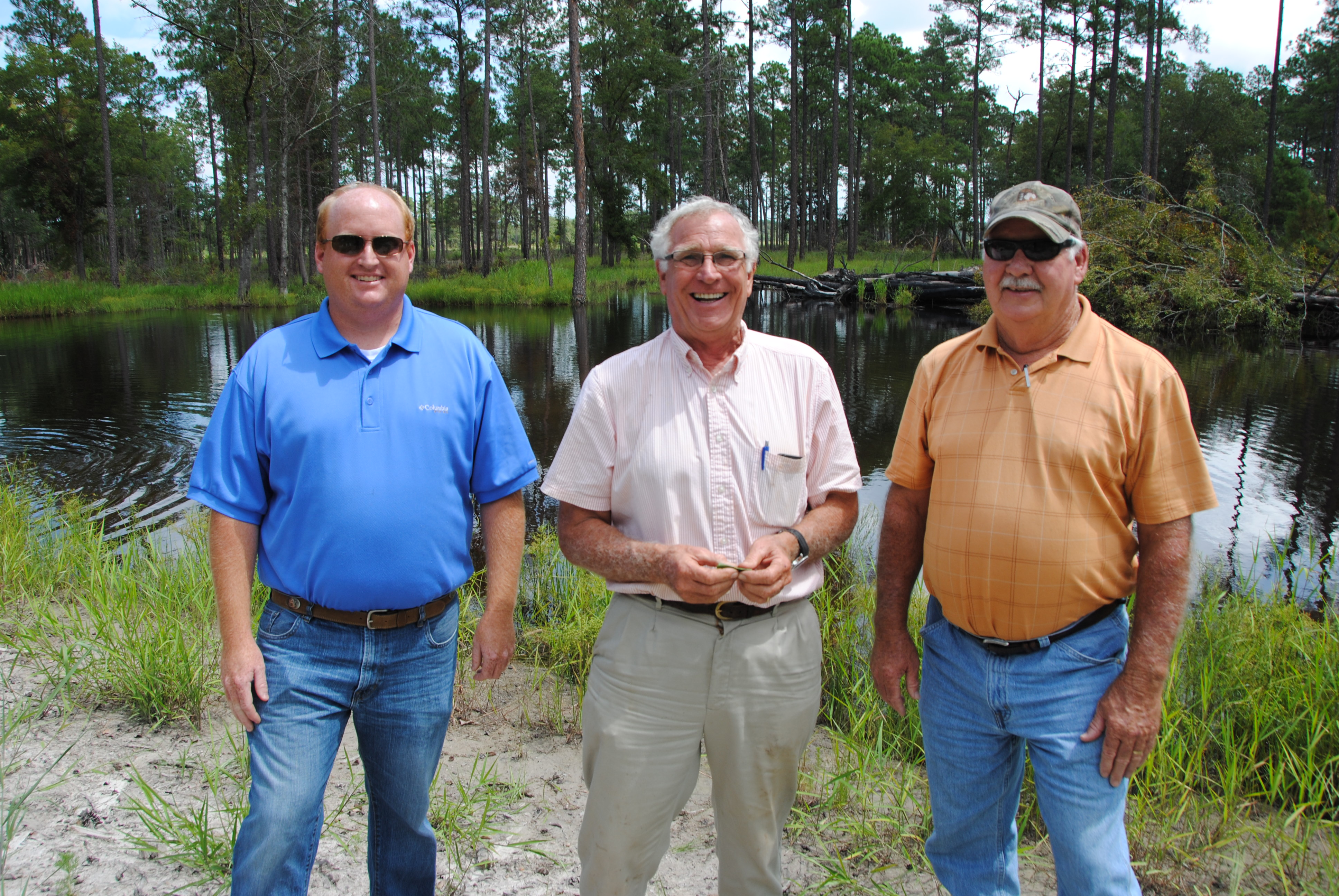 Royce McCrary (center) worked with his local NRCS office on a WRP contract.