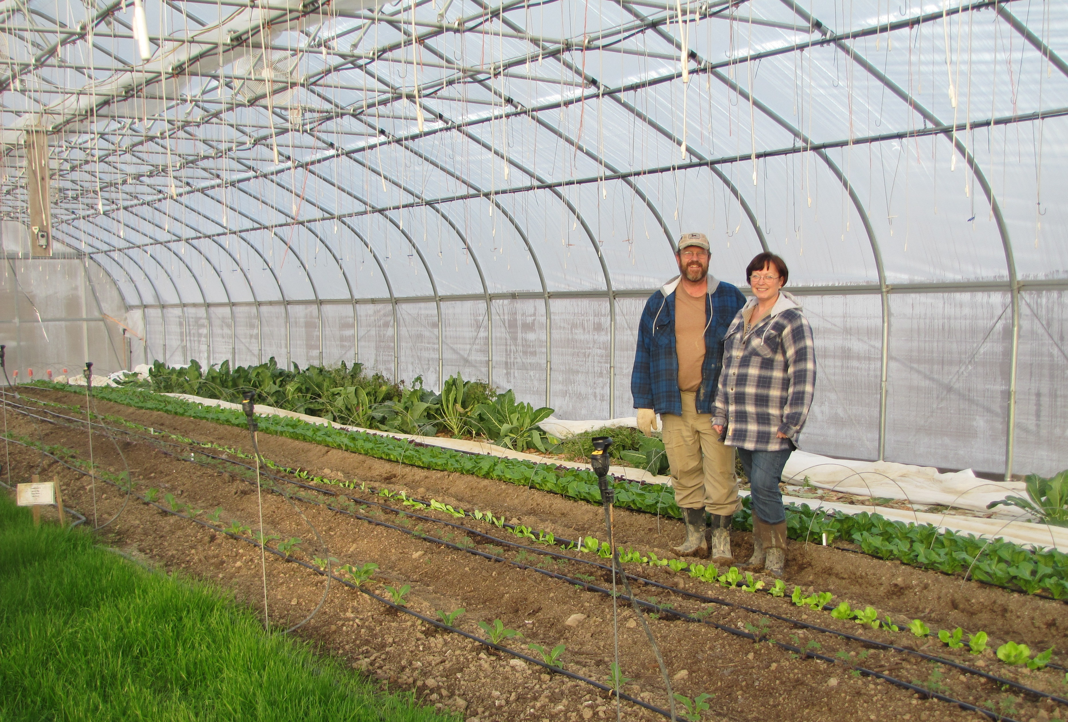 Lisa and Jeff Sickler from Philippi with their newly constructed seasonal high tunnel.