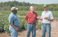Ronnach Day, Conway County district conservationist, and Barry McKuin and Joe Torian discuss the work done on Cadron Six Farms.