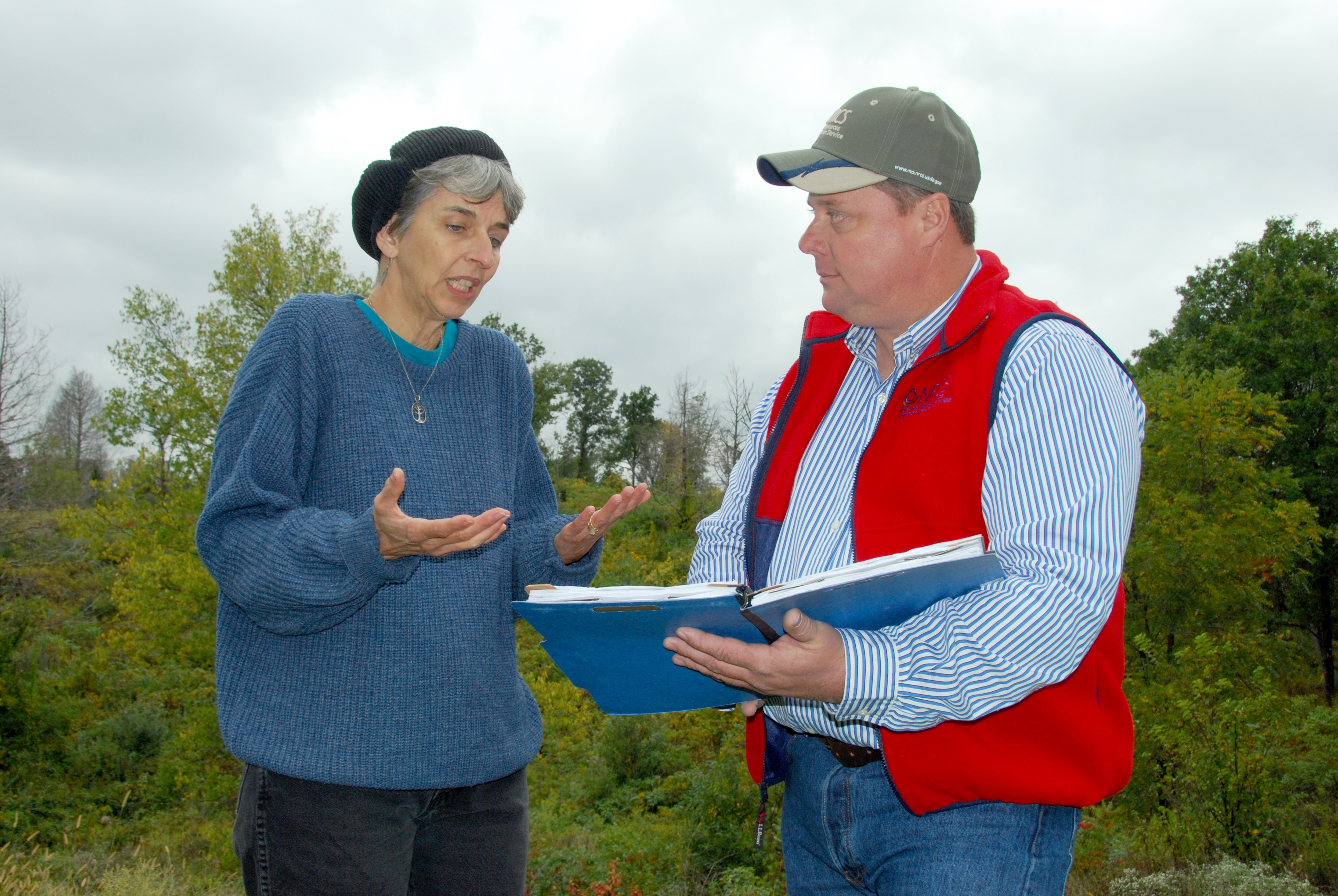 Theresa Lackey and District Conservationist Tony Hoover look over Lackey's Conservation Plan.