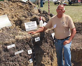 Roger Windhorn, NRCS resource soil scientist, explains soil properties.